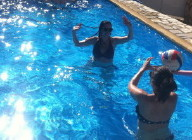 Guests having fun in Villa Henri's pool